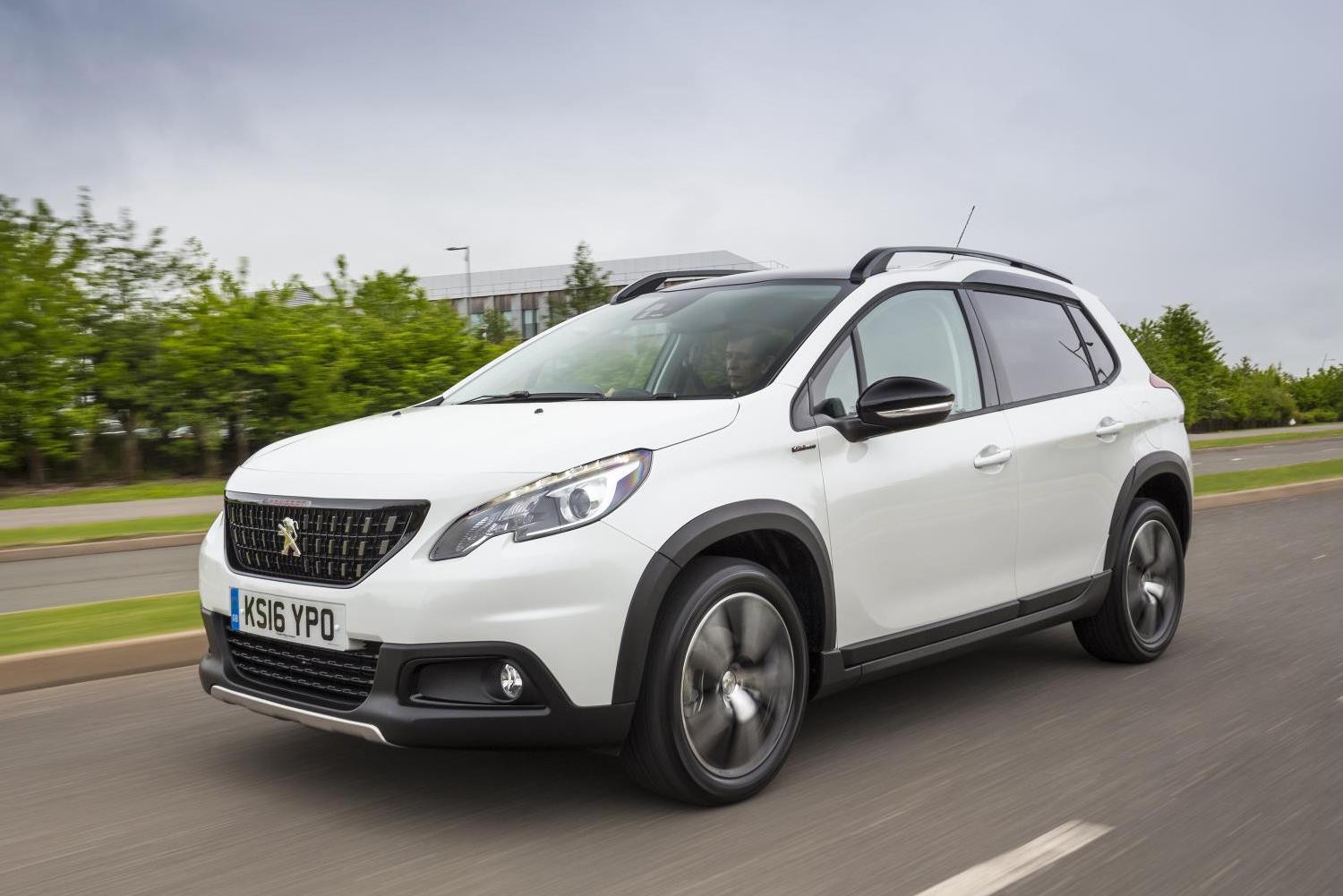 White Peugeot 2008 driving on a dual carriageway towards the left