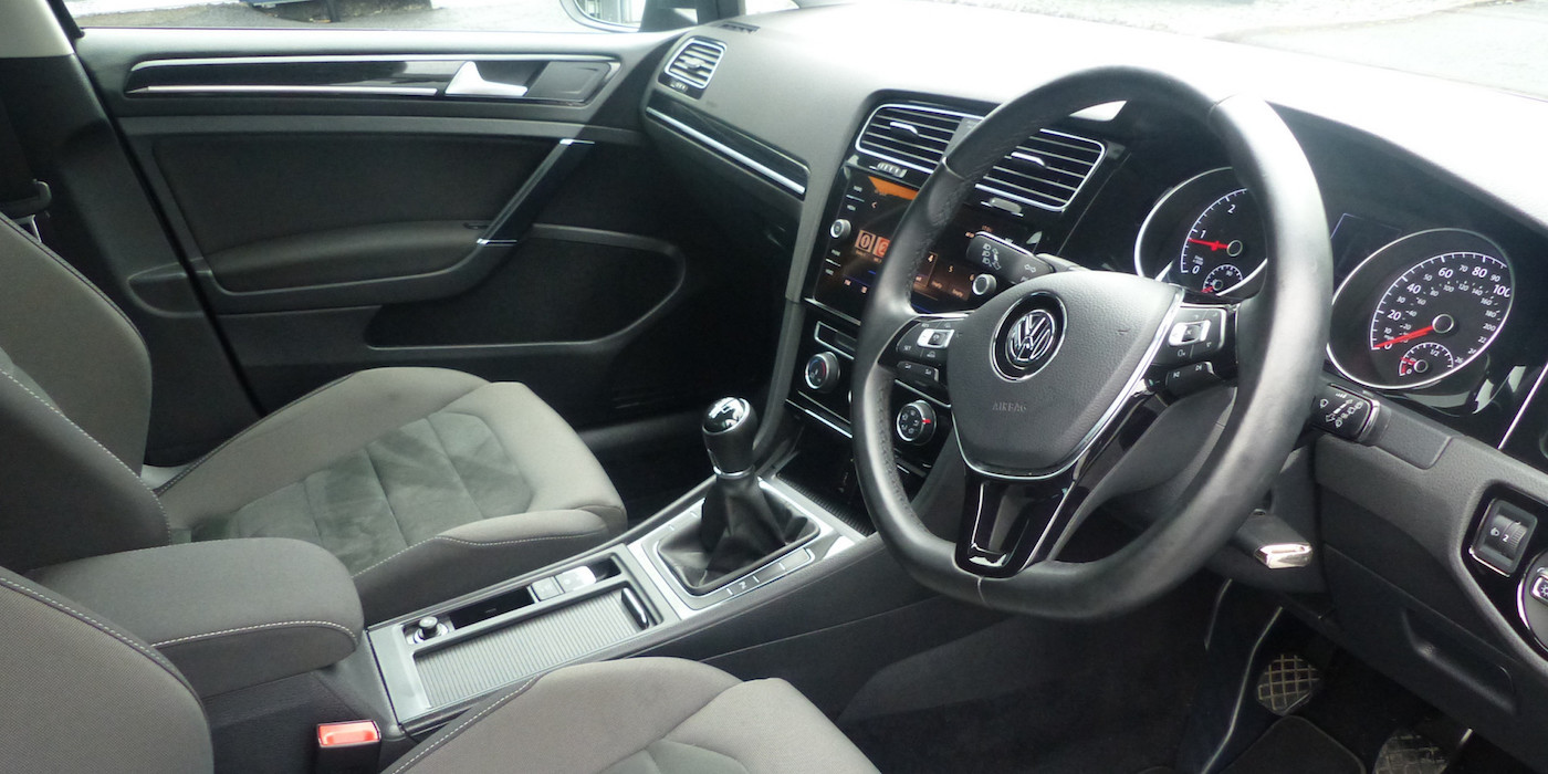 Front interior of VW Golf.