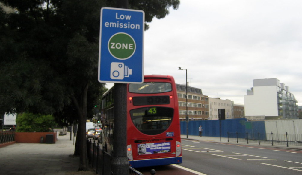 Low emissions sign next to red London bus